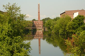 Nashua Manufacturing Company Historic District - Nashua Millyard with Truss bridge to North cotton storehouse (right)