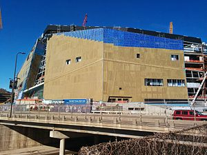 U.S. Bank Stadium - From directly east of the stadium: the southeast facade with doors and windows going in, as well as the northeast facade with part of its exterior wall up.