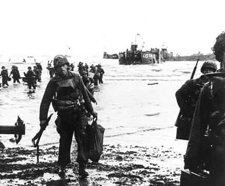 Carrying their equipment, US assault troops move onto Utah Beach. Landing craft can be seen in the background. Normandy 1.jpg