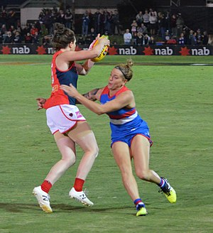 AFL Women's - Melbourne's Elise O'Dea evades Hannah Scott of the Western Bulldogs in round 3, 2017