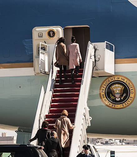 Malia and Sasha Obama prepare to enter Air Force One, Michelle Obama and President Obama behind them, on March 7, 2015. Obama heads to Selma for 50th anniversary speech 150307-F-WU507-020.jpg
