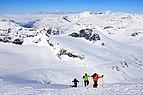 Off-piste skiers ready for takeoff from Storebjørn peak in Jotunheimen.jpg