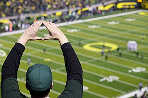 "O (gesture) - A fan ""throwing the O"" at an Oregon Ducks football game in 2011"
