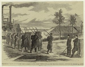 1st Louisiana Native Guard (United States) - Troops of the Louisiana Native Guard disembarking at Fort Macomb, Louisiana, for guard duty.