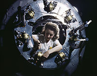 Part of the cowling for one of the motors for a B-25 bomber is assembled in the engine department of North American Aviation.jpg
