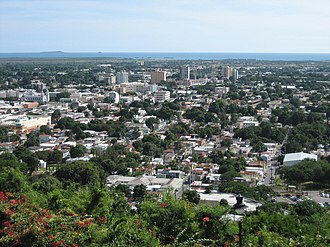 Ponce, Puerto Rico - Partial view of Ponce in 2006 as seen from Cerro del Vigía, with the Caribbean Sea and Caja de Muertos in the background