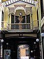 Pasaje Gutierrez en Valladolid con detalle de la puerta y el reloj.jpg