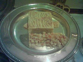 Sacramental bread - The Lamb and particles placed on the diskos during the Liturgy of Preparation for the Divine Liturgy