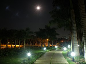 Diffraction spike - Image: Path near floating restaurant, with moon, Infosys Mysore