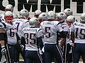 Patriots in huddle pregame at New England at Oakland 12-14-08.JPG
