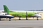 Pel-Air Saab 340B (VH-ZXS) in former Happy Air Travellers livery parked on the tarmac at Wagga Wagga Airport (1).jpg