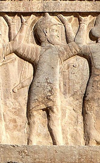 "Achaemenid Macedonia - ""Ionian with shield-hat"" on the tomb of Artaxerxes II (circa 360 BC)."