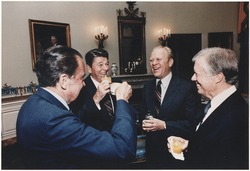 Photograph of four former U.S. Presidents, including Ronald Reagan, celebrating in a blue room before leaving for Egypt