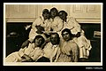 Photographic postcard of a man and five women (10255237004).jpg