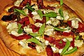 Pizza with dried tomato, brie, basil and olive oil.jpg