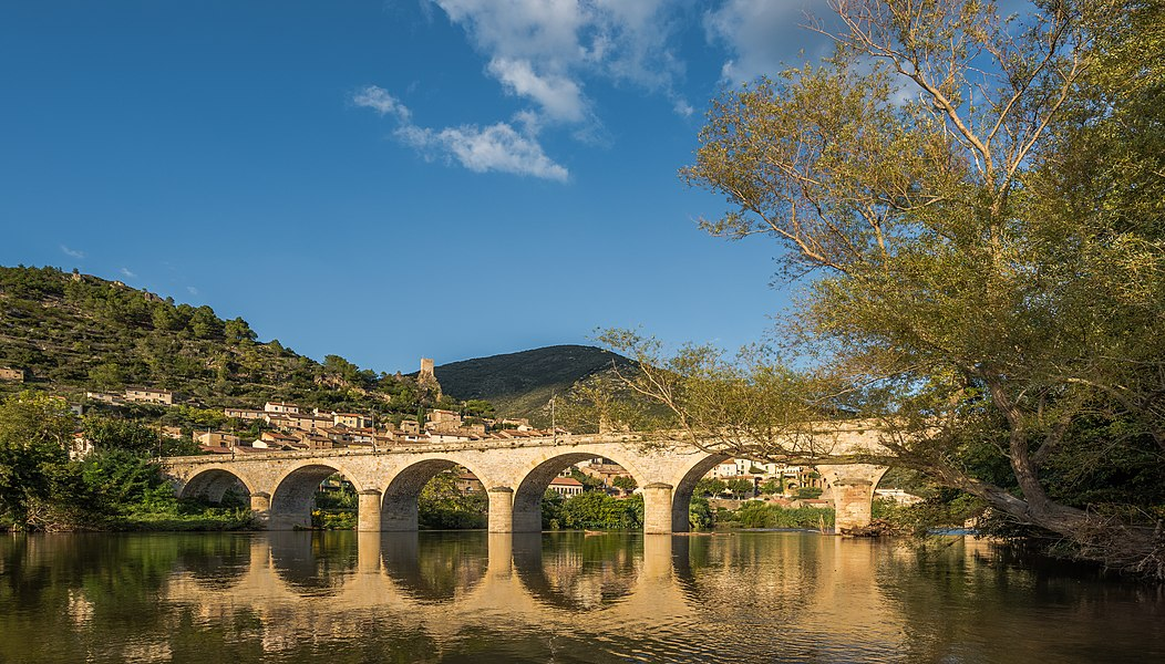 The Bridge above the Orb River, arch bridge of 7 archs dated from 1870. Seen from the Southwest.Roquebrun, Hérault, France. Haut-Languedoc Regional Natural Park.