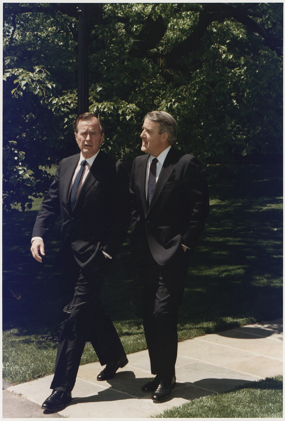 President Bush walks with Prime Minister Mulroney of Canada on the White House Grounds - NARA - 186392