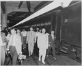 President Harry S. Truman walking in a station, beside the presidential train. President Truman was on a trip to... - NARA - 199929.tif