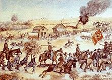 Armed men on horses escorting unarmed men on foot