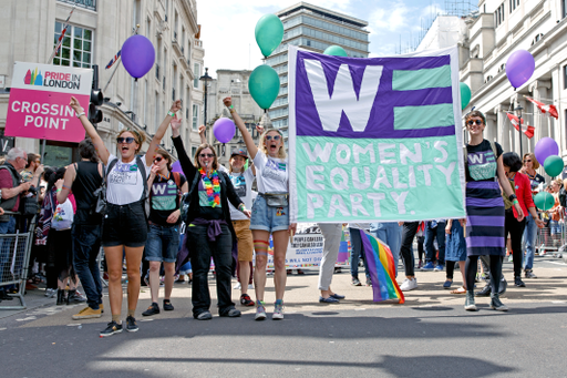 Pride in London 2016 - Enthusiastic members of the Women's Equality Party in Trafalgar Square