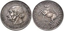 Kopfbild auf der 1-Billion-Mark-Münze Notgeld der Provinz Westfalen, 1923 (Quelle: Wikimedia)