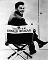 Publicity photograph of Ronald Reagan sitting in General Electric Theater director's chair.jpg