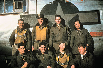 """RAF Bungay - A bomber crew, led by Lieutenant Grant, of the 706th Bomb Squadron, 446th Bomb Group with their B-24J-155-CO Liberator (RT-H, serial number 44-40268) nicknamed """"Kentucky Belle""""."""