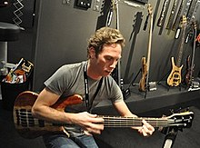 A man playing bass guitar