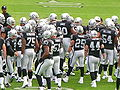 Raiders in huddle pregame at Atlanta at Oakland 11-2-08.JPG