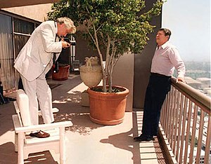 Harry Benson - President Ronald Reagan poses for Benson on the balcony of the Ronald Reagan Suite, Century Plaza Hotel, 28 August 1987
