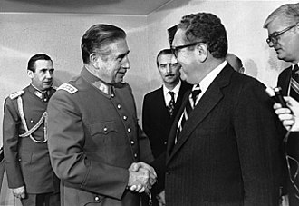 Criticism of United States foreign policy - Chilean leader Augusto Pinochet shaking hands with Henry Kissinger in 1976.