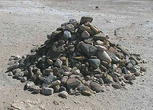 Pile of rocks started by Nelson Mandela and ad...
