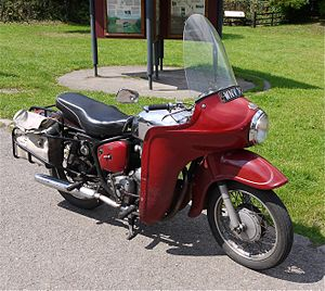Motorcycle fairing - Royal Enfield Bullet with factory-optional Airflow touring-fairing and matching front wheel streamlining