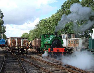 "Rutland Railway Museum - Hawthorn Leslie ""Singapore"" hauling a train of mineral wagons."