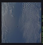 STS088-725-021 - STS-088 - SAC-A satellite in orbit over the Earth.jpg