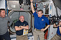 STS 134 crew and Expedition 27 crew shortly after hatch opening.jpg