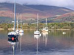 Sailing yachts at nichol end facing south into winter sun. The magnificent mountains behind show the low cloud on Skiddaw and Blencathera