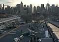 Sailors & Marines aboard the USS Bataan (LHD 5) man the rails as the ship departs New York.jpg