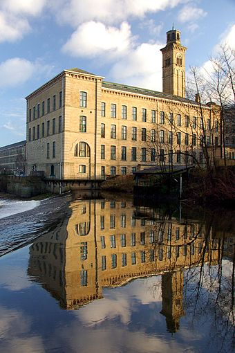 Saltaire, West Yorkshire, is a model mill town from the Industrial Revolution, and a World Heritage Site. Saltaire New Mill Reflected.jpg