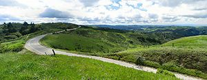 San Francisco Bay Area - Skyline Boulevard stretches through the Santa Cruz Mountains, here atop Portola Valley, California. During the winter and spring, hills surrounding the San Francisco Bay Area are lush and green.