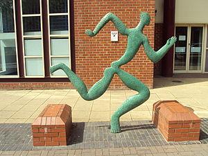 Running man sculpture outside the Sport, Exerc...