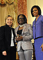 Secretary Clinton With First Lady Michelle Obama and Jestina Mukoko (4425068927) (cropped).jpg