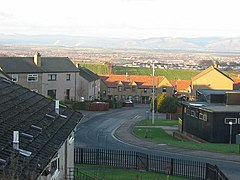 A view over houses with the Forth Valley and Ochil Hills in the background