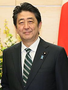 Shinzō Abe with Japanese flag (2017).jpg