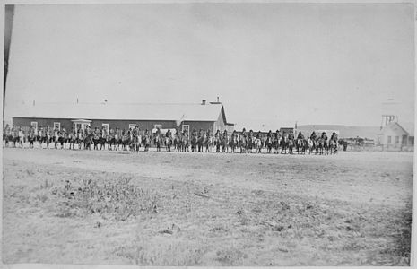 Sioux Indian police lined up on horseback in front of Pine Ridge Agency buildings, Dakota Territory