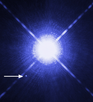 White dwarf - Image of Sirius A and Sirius B taken by the Hubble Space Telescope. Sirius B, which is a white dwarf, can be seen as a faint point of light to the lower left of the much brighter Sirius A.