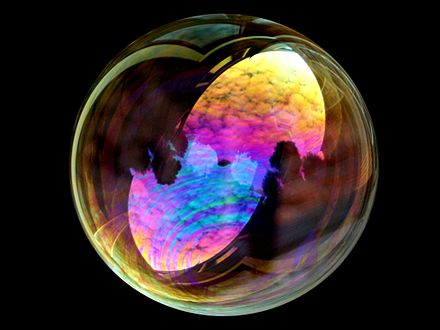 White light interference in a soap bubble. The iridescence is due to thin-film interference. Soap bubble sky.jpg