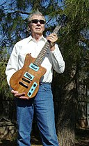 Sonny West with guitar he made from Texas Mesquite wood.jpg