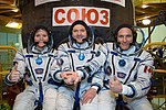 Soyuz MS-11 crew members in front of their spacecraft.jpg
