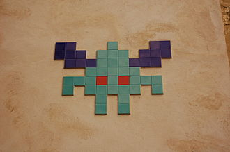 Galaxian - Street art mosaic of one of the characters (upside-down while in formation, this way up while attacking) made by Invader